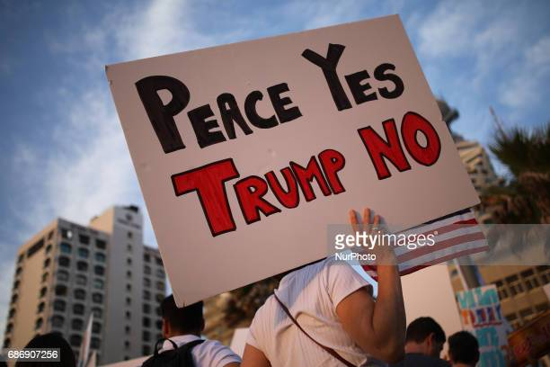 Israeli and American activists protest against President Donald Trump next to the US embassy in Tel Aviv in the context of Trump's visit to Israel...