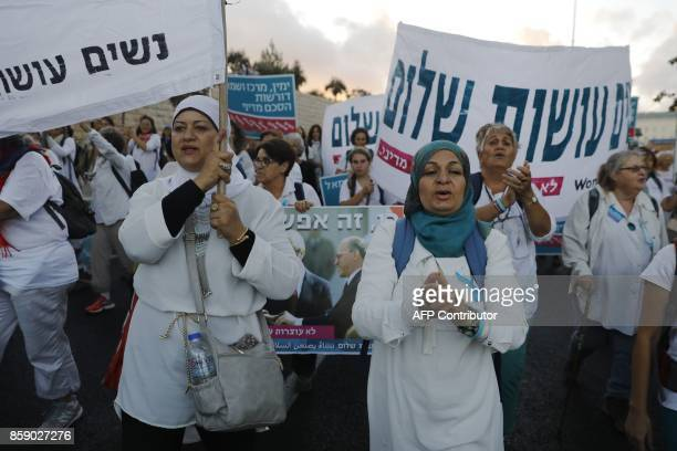 Israeli and Palestinian activists of the Women Wage Peace movement march in the heart of Jerusalem on October 8 2017 demanding a far elusive peace...