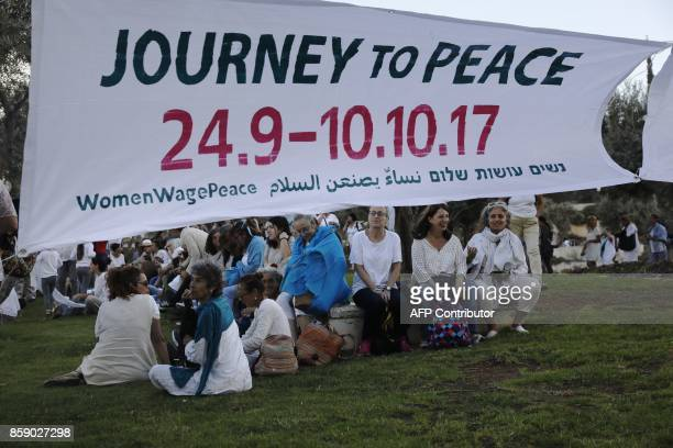 Israeli and Palestinian activists of the Women Wage Peace movement take part in a rally in the heart of Jerusalem on October 8 2017 demanding a far...