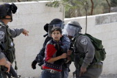 Israeli antiriot policemen detain a Palestinian boy during a protest in Aida refugee camp near the West Bank city of Bethlehem on November 16 2012...