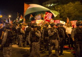Israeli Arabs and Israeli left wing activists protest against the Israeli attack on Gaza in the northern Israeli city of Haifa on July 19 2014 AFP...