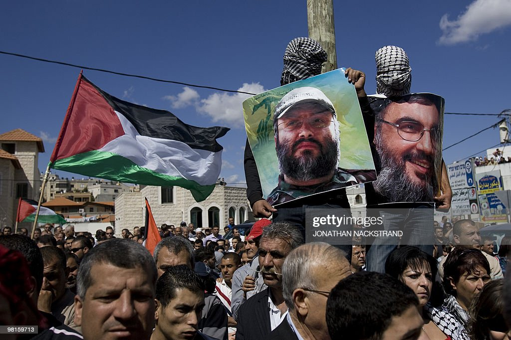 Israeli Arabs carry portraits of Lebanese Hezbollah Chief Hassan Nasrallah and assasinated Hezbollah military leader Imad Mughniyeh during a...