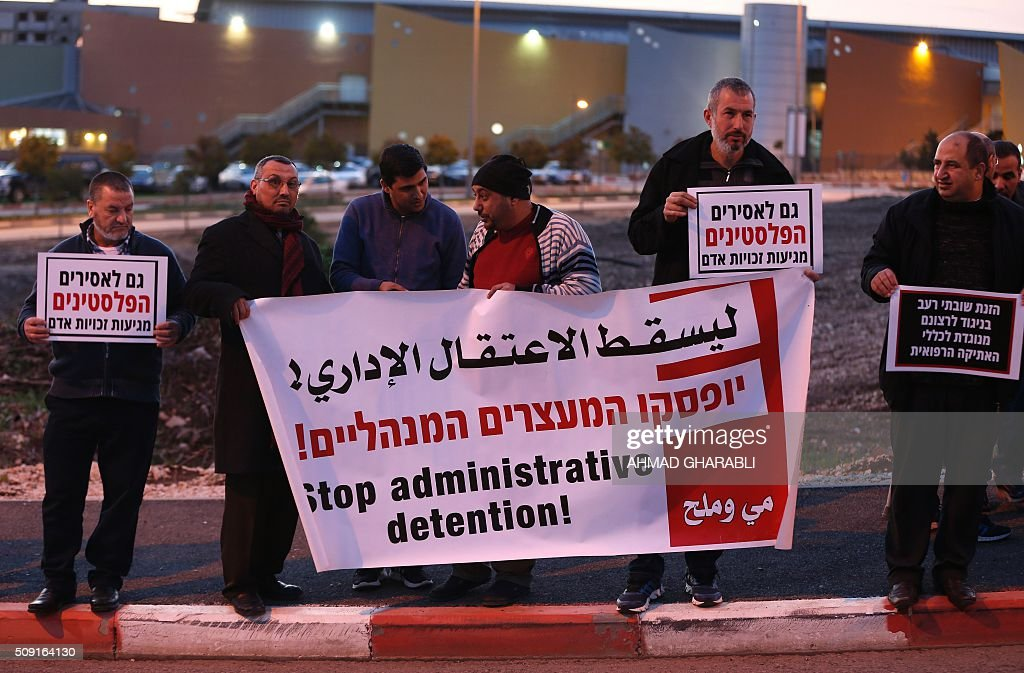 Israeli Arabs take part in a protest calling for the release of Mohammed al-Qiq, a Palestinian prisoner on hunger strike, outside a hospital in the northern Israeli town of Afula on February 9, 2016. Ailing Palestinian journalist Mohammed al-Qiq will keep up his 10-week hunger strike despite Israel suspending a detention without trial order against him, his lawyer said. The 33-year-old television reporter, who still cannot leave hospital without permission, is 'determined to continue his fast until he is freed', Jawad Boulos told AFP. GHARABLI