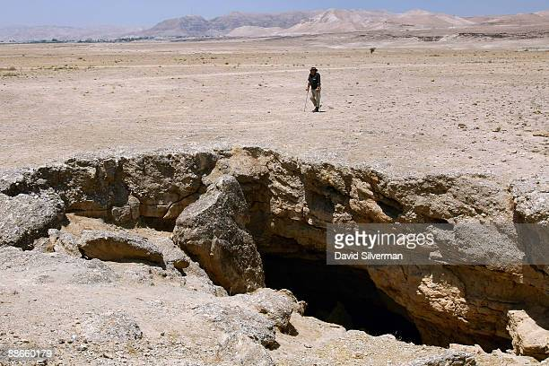 Israeli archaeologist Professor Adam Zertal walks towards the opening of an artificial underground cave quarry which he dates to the 1st century AD...