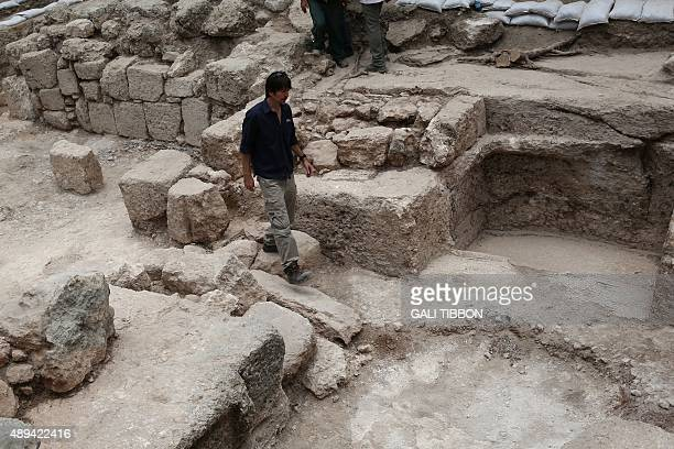 Israeli archeologist Amit Re'em of the Israel Antiquities Authority walks on September 21 2015 at the site of excavations where a large Mausoleum was...