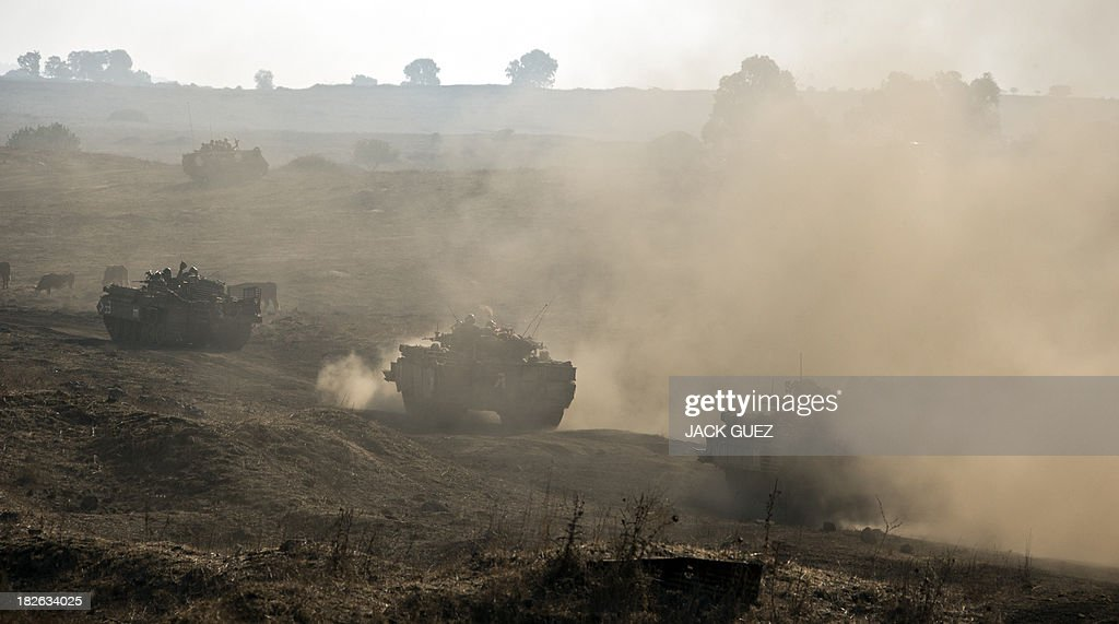 Israeli army Armored Personnel Carriers maneuver during a military exercise near the northern border with Syria in the Israeliannexed Golan Heights...