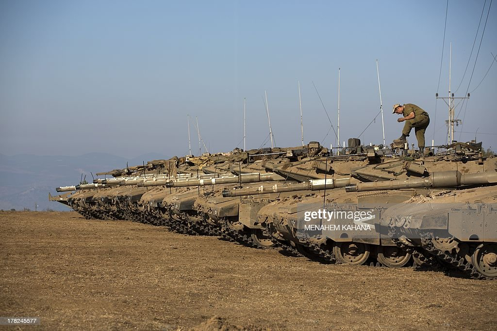 Israeli army Merkava tanks are seen stationed in a deployment training area in the Israeli-annexed Golan Heights near the border with Syria on August 28, 2013. Israel will strike back 'fiercely' if Syria attacks the Jewish state, Prime Minister Benjamin Netanyahu said, as the US mulled military action against President Bashar al-Assad's regime.