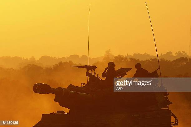 Israeli Army mobile artillery redeploy during sunset near the border with the Gaza Strip on January 5 2009 Israeli troops and Hamas fighters battled...
