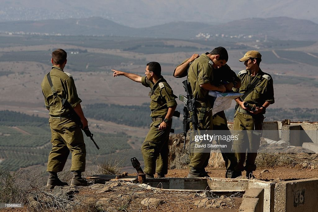 Israeli troops deployed at golan heights photos and images getty israeli army officers study a map as they view the border area with syria from the sciox Gallery