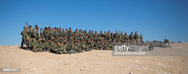 Israeli army recruits who were drafted to the Givati infantry brigade about six months ago attend a training session marking the end of their basic...