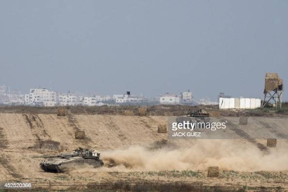 Israeli army tanks hold a position on the Israeli side of the border with the Gaza Strip on July 22 2014 The UN chief and Washington's top diplomat...