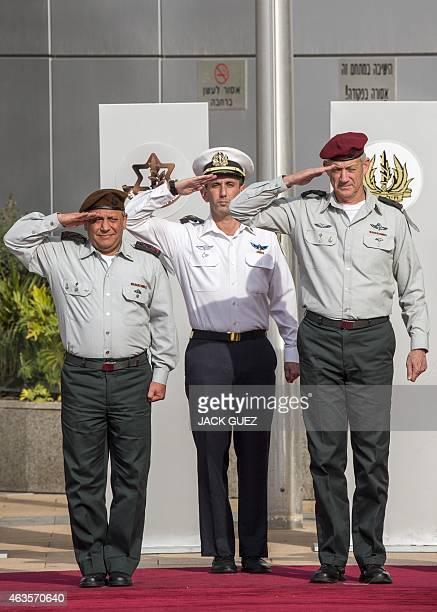 Israeli Army's new Chief of Staff Lieutenant General Gadi Eizenkot and his predecessor Lieutenant General Benny Gantz salute during his farewell...
