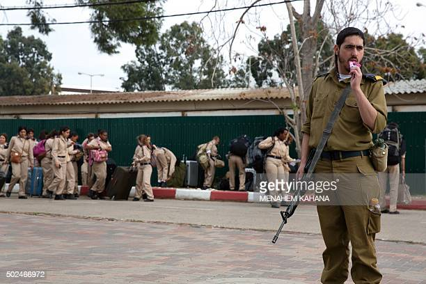 SMITH Israeli army's newlyenrolled soldiers of the Shachar Kachol UltraOrthodox Jewish unit take are seen at the technical Air force base on November...