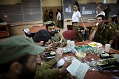 SMITH Israeli army's newlyenrolled soldiers of the Shachar Kachol UltraOrthodox Jewish unit bless the food as they have lunch during a training...