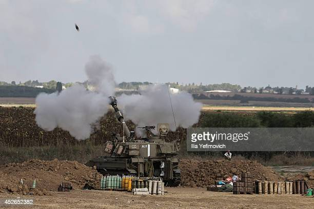 Israeli artillery fire near the IsraeliGaza border on July 25 2014 near Israel's border with the Gaza Strip As operation 'Protective Edge' enters its...