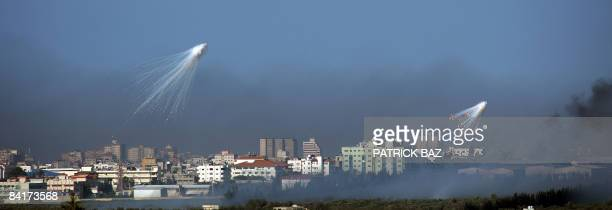Israeli artillery shells explode over the northern town of Beit Lahia in the Gaza Strip on January 4 as seen from the Israeli side of the IsraelGaza...