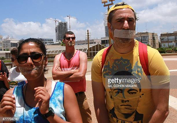 Israeli artists wear a tape over their mouths as they take part in a protest against Minister of Sports and Culture Miri Regev upon her arrival to a...