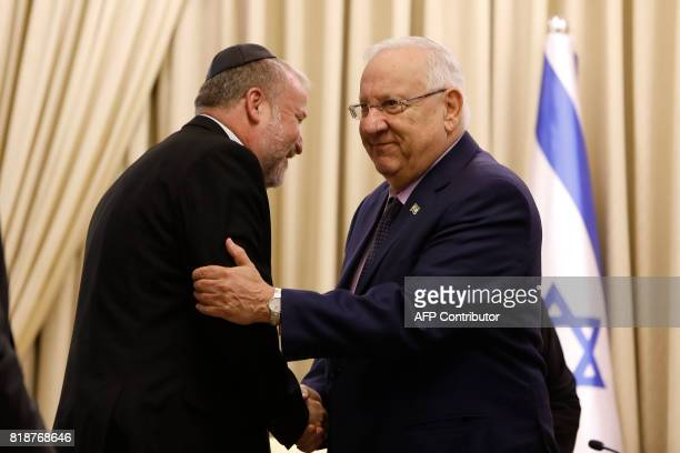Israeli attorney general Avichai Mandelblit shakes hand with Israeli President Reuven Rivlin during an event at the Presidential compound in...