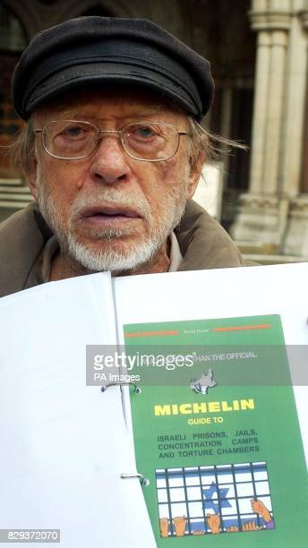 Israeli author Shimon Tzabar shows the cover of his guide book after leaving London's High court Michelin have dropped its High Court action against...