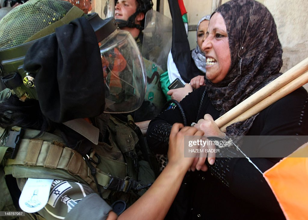 Israeli boarder police arrest a Palestinian woman during a demonstration against the Israeli occupation and to mark 'Naksa Day' the 44th anniversary...