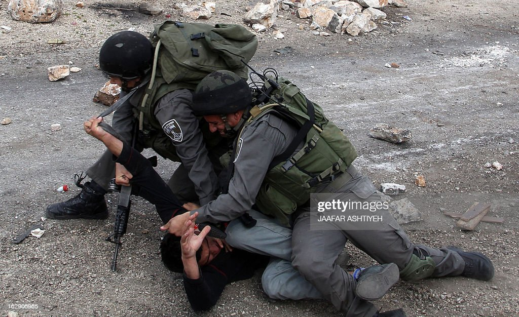 Israeli border guard detain a Palestinian during clashes following a protest against the against the expropriation of Palestinian land by Israel on March 1, 2013, in the village of Kafr Qaddum, near the occupied West Bank city of Nablus.