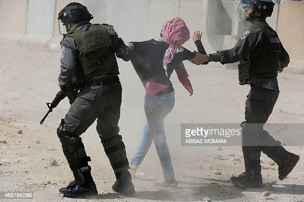 Israeli border guards detain a Palestinian protester during clashes following a demonstration by students from Birzeit University near Ramallah...