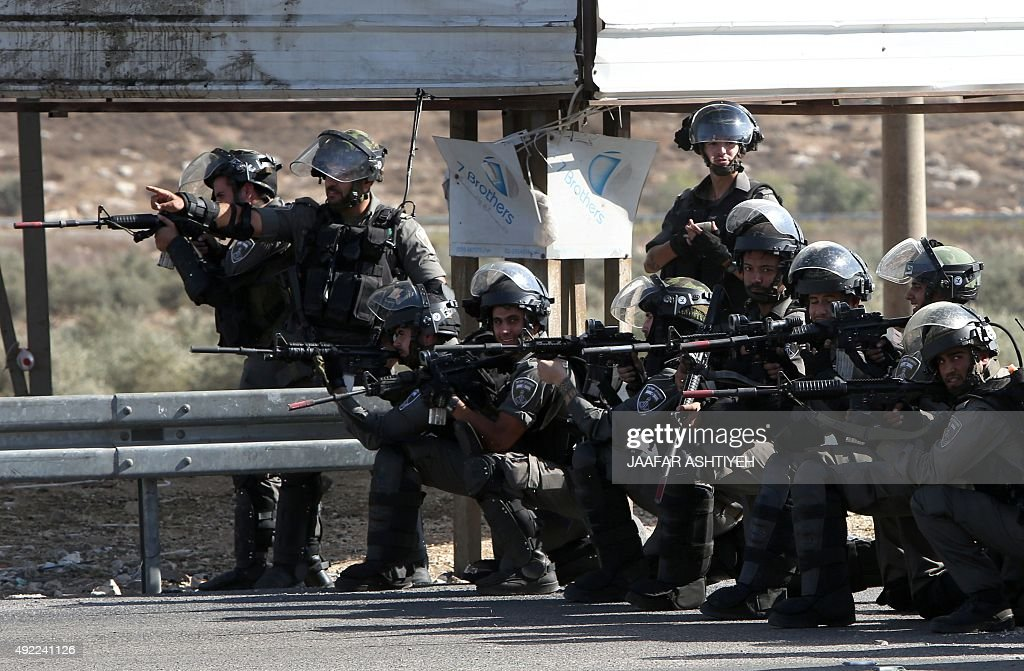 Israeli border guards keep position during clashes with Palestinian protestors at the Hawara checkpoint south of the West Bank city of Nablus on...