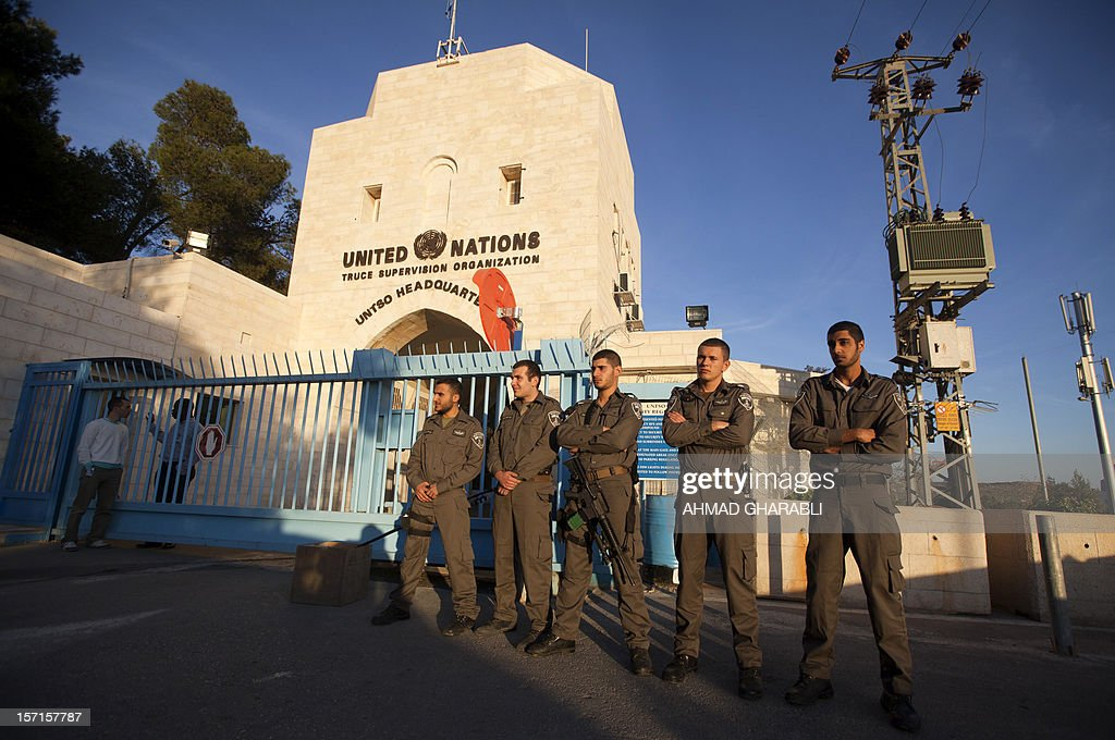 Israeli border guards secure the UN's headquarters in Jerusalem on November 29, 2012 as a handful of ultra-nationalist Israelis led by two members of the Knesset (Israeli Parliament) stage a rally protesting the Palestinian bid to upgrade their UN status outside the . UN leader Ban Ki-moon warned ahead of key vote on UN recognition of a Palestinian state that the Middle East peace process is on 'life support'. AFP PHOTO / AHMAD GHARABLI