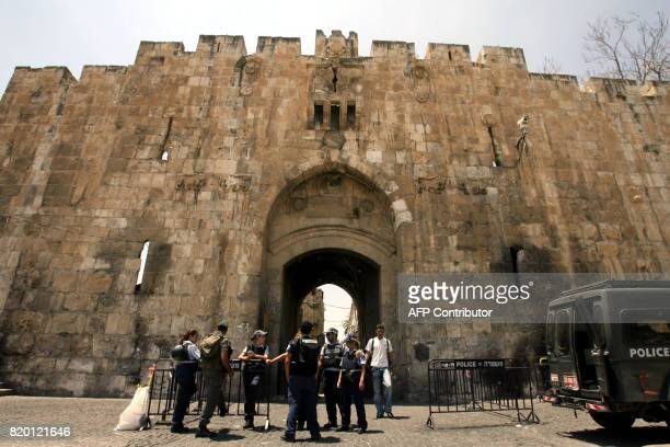 Israeli border police are seen at the entrance of Damascus Gate which leads into annexed East Jerusalem's old city 03 August 2006 Security was high...