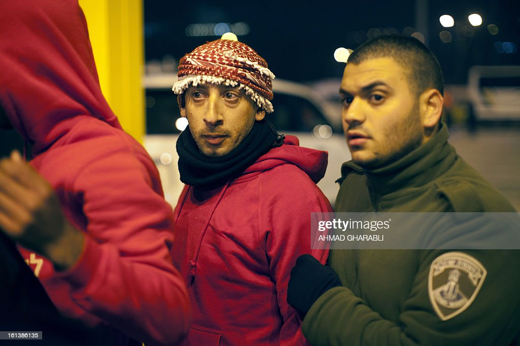 Israeli border police arrest a Maccabi Bnei Sakhnin supporter during an Israeli championship football match between Beitar Jerusalem and Bnei Sakhnin at the Teddy Kollek Stadium in Jerusalem on February 10, 2013. The Beitar Jerusalem soccer club hosted the Israeli Arab team Bnei Sakhnin in a highly charged atmosphere, only three days after indictments were filed against four Beitar fans over charges relating to racism.