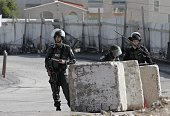 Israeli border police stand guard near the Abu Jamal residence in the east Jerusalem neighbourhood of Jabal Mukaber on November 18 a few hours after...