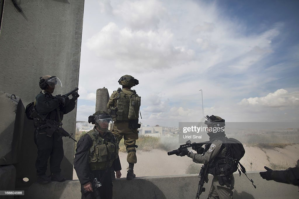 Israeli border policemen take up positions during clashes with Palestinian protesters during Nakba day on May 15, 2013 near the Qalandia checkpoint at the outskirts of Ramallah, the West Bank. Palestinians mark Israel's establishment in 1948 with 'Nakba' or 'catastrophe' day on May 15, to remember the thousands of Palestinians who fled or were expelled during the creation of the Jewish state and the subsequent war.