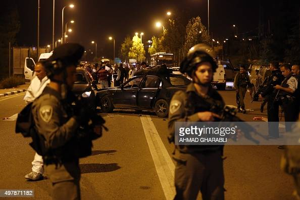 Israeli borderguards stand guard at the site of an attack that left one Israeli dead and eight wounded in the Jewish settlement bloc of Gush Etzion...