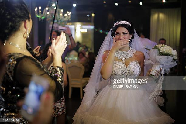 Israeli bride Morel Malcha is pictured ahead of her wedding ceremony to Arab Israeli Muslim groom Mahmoud Mansour in Mahmoud's family home in the...