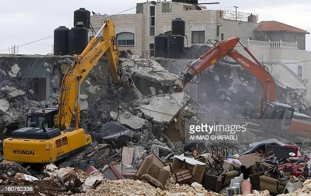 Israeli bulldozers destroys a Palestinian house in the Arab east Jerusalem neighborhood of Beit Hanina on February 5 2013 Palestinian homes built...