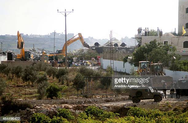 Israeli bulldozers early Tuesday demolished a milk parlor and two barns by reason of that the building had been constructed without the necessary...