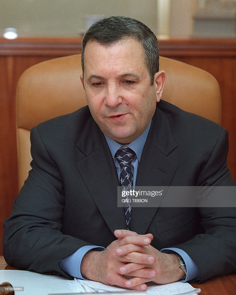 Israeli caretaker Prime Minister Ehud Barak reflects at the start of the weekly cabinet meeting 31 December 2000 in Jerusalem as a new day of...