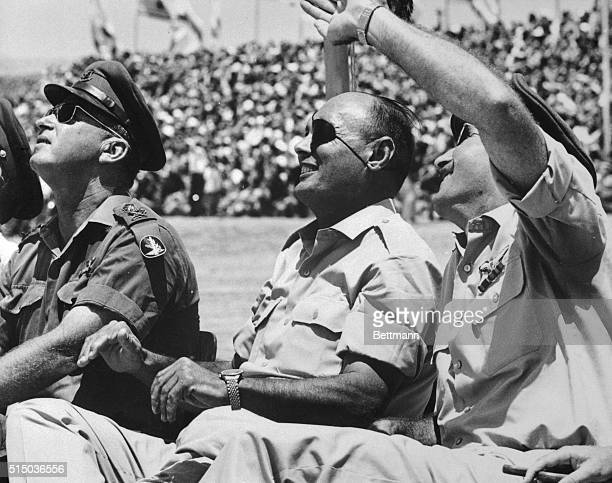 Israeli chiefs watch an air show over the Negev Brigade Monument in celebration of Israel's military victory in the 6Day War with Egypt Jordan and...