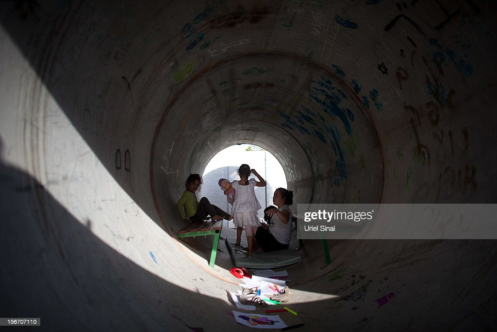Israeli children play in a large concrete pipe used as a bomb shelter on November 19, 2012 in Nitzan, Israel. According to reports November 19, 2012, at least 90 Palestinians have been killed and more than 700 wounded during the Israeli offensive in the Gaza Strip.