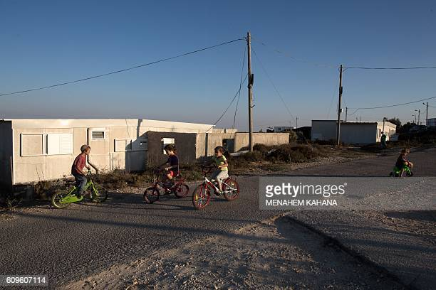 Israeli children play outside their home in the wildcat Amona settlement northeast of the Palestinian city of Ramallah in the Israeli occupied West...