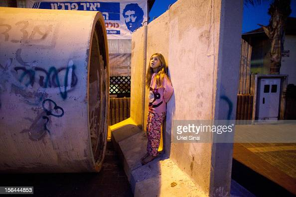 Israeli children run to a large concrete pipe used as a bomb shelter during a rocket attack from the Gaza Strip on November 15 2012 in Nitzan Israel...