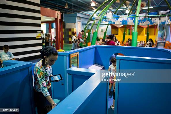 Israeli children seen in a special bomb shelter playground on July 14 2014 at the city of Sderot Israel's operation 'Protective Edge' has entered a...