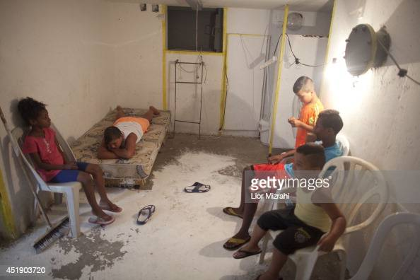 Israeli children sit in a shelter on July 9 2014 in Ashkelon Israel Due to recent escalation in the region the Israeli army started new deployments...