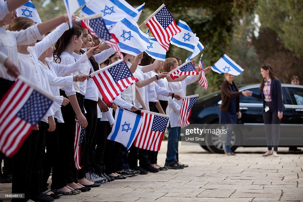 Israeli children wave flags during a rehearsal, a day a head of the arrival of US President Barack Obama at the president's residence on March 19, 2013 in Jerusalem, Israel. Obama will make his first visit as President to the region tomorrow, and his itinerary will include meetings with the Palestinian and Israeli leaders as well as a visit to the Church of the Nativity in Bethlehem.