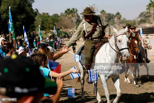 Israeli children welcome members of the Australian Light Horse association as they ride their horses on October 29 2017 near BeerSheva on the...