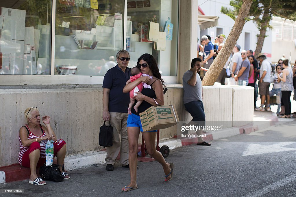 Israeli citizens gather at central post office in Tel-Aviv to change and pick up gas mask as tension surrounding the Syria crisis escalates, on August 29, 2013 in Tel Aviv, Israel. After widespread international condemnation of Syria's alleged use of chemical weapons, the prospect of a US-led military intervention into Syria looms closer.