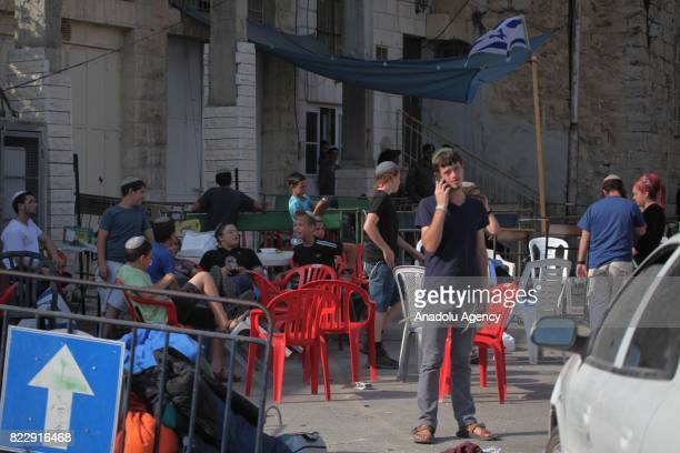 Israeli citizens gather in front of a house in Hebron West Bank on July 26 2017 Abu Rajab family are dismissed from their house which is located in...