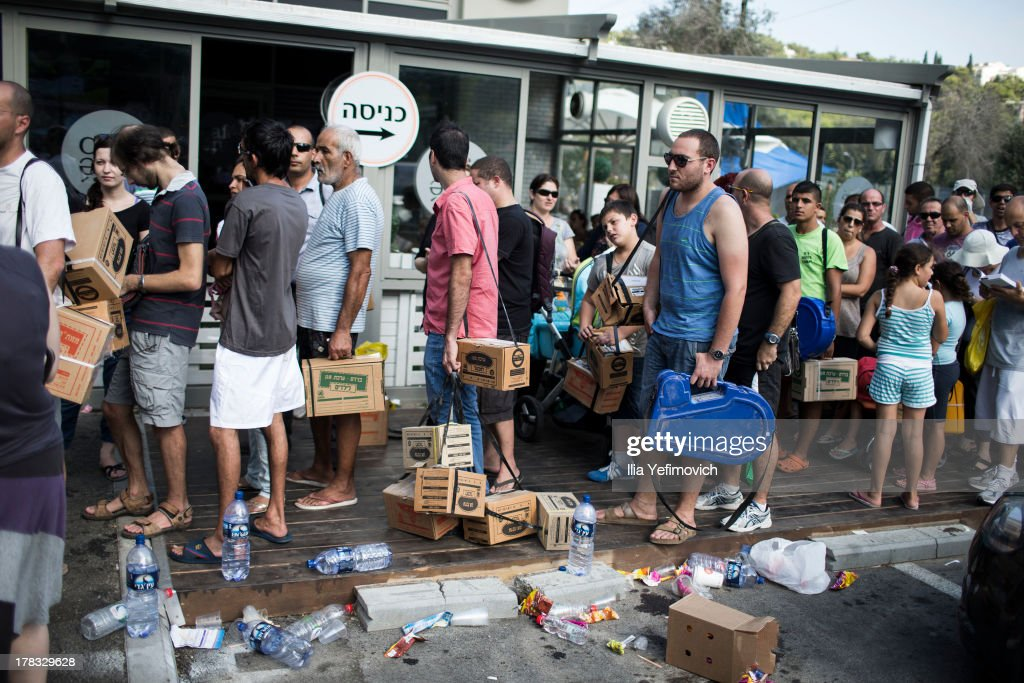 Israeli citizens gather in the city of Haifa to change and pick up gas masks as tension surrounding the Syrian crisis escalates on August 29, 2013 in Haifa, Israel. After widespread international condemnation of Syria's alleged use of chemical weapons, the prospect of a US-led military intervention into Syria looms closer.