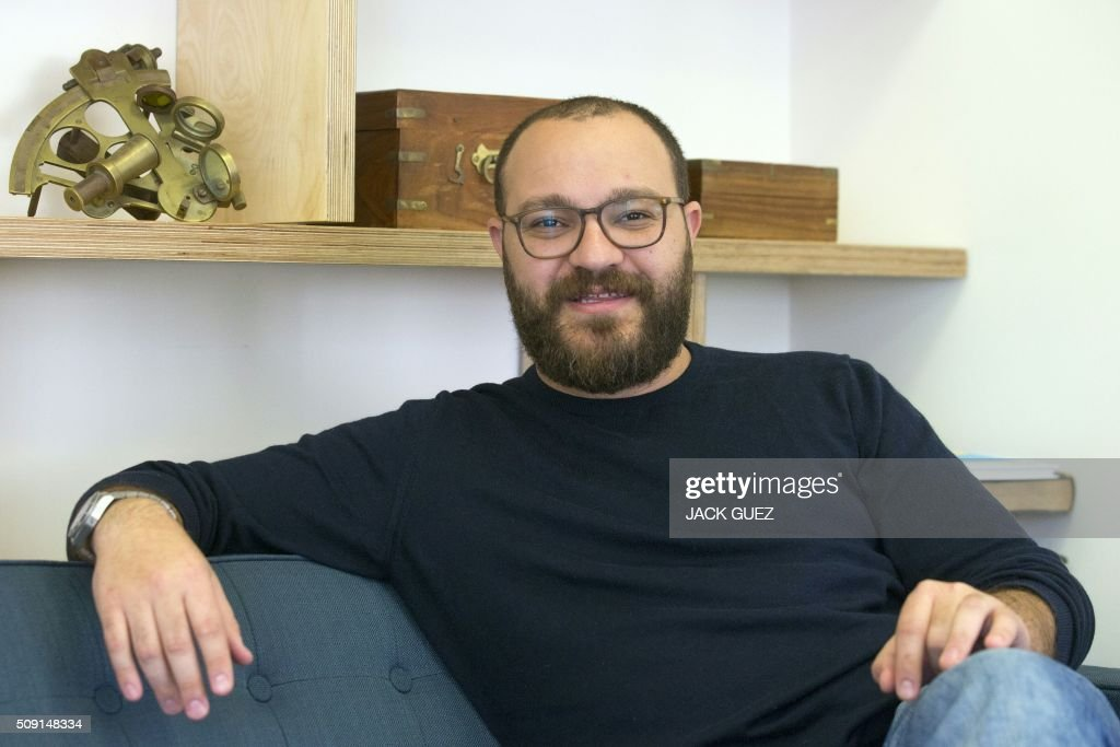 Israeli co-founder of the Windward company Matan Peled poses at the company's offices on February 9, 2016 in the Israeli city of Tel Aviv. At a time of deep concern over migrant smuggling, Daniel, a former member of the Israeli navy, says his company Windward has the ability to pick up such suspicious maritime behaviour that would otherwise go unnoticed. GUEZ