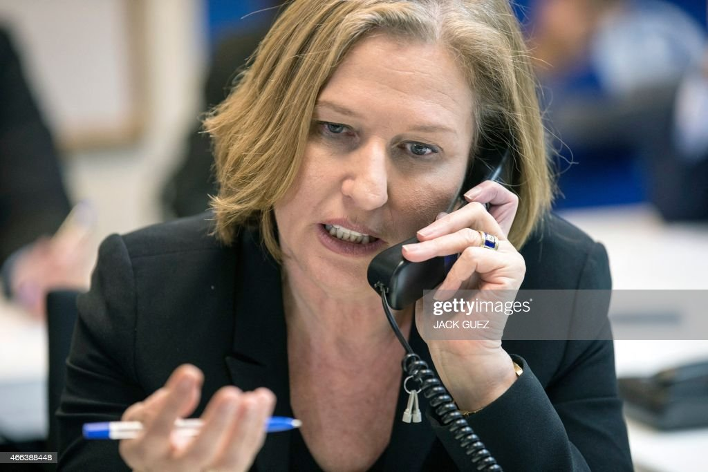 Israeli co-leader of the Zionist Union list for the upcoming general election, MP <a gi-track='captionPersonalityLinkClicked' href=/galleries/search?phrase=Tzipi+Livni&family=editorial&specificpeople=537394 ng-click='$event.stopPropagation()'>Tzipi Livni</a> talks on the phone with citizens to try to convince them to vote for them, at the party headquarters in the Israeli coastal city of Tel Aviv, on March 15, 2015, two days ahead of the elections. AFP PHOTO / JACK GUEZ